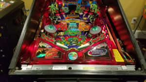 This game has a beautifully restored playfield with bright vivid colors, and of course, jumping alien toys.