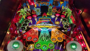 A detail showing the colorful art. This playfield was clearcoated for an extra shine and years of protection.