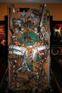 Underside of playfield was stripped, cleaned, and rebuilt.