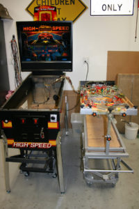 Many restorations are performed with the playfield taken out of the cabinet and mounted on a playfield rotisserie
