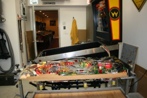 This enables full access to the playfield to perform highly detailed restoration work. This type of work is generally reserved for installing new old stock or replacement playfields or playfield restoration work such as touching up and clearcoating.
