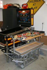 With this custom made rotisserie it actually allows the playfield to be powered up so that fine tuning can take place on the rotisserie and not inside the cabinet.