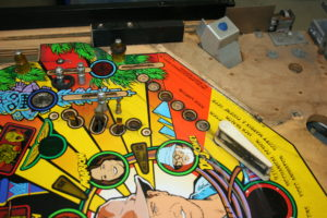 The top side of the playfield will be clear-coated with durable automotive clear-coat. First the dirt must be thoroughly cleaned and black key lines will be touched up.