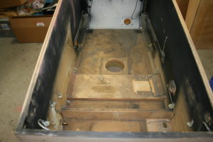 The interior of the cabinet was stripped down to bare wood and all surfaces will be sanded.